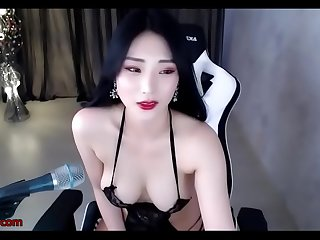 Stunning Korean in lingerie oils her body