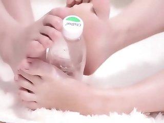 Loli girl playing with bottle