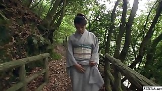 Amazingly beautiful JAV milf Akemi Horiuchi in a kimono flashes her lower body while outdoors in a forest before kneeling to perform a blowjob in HD with English subtitles