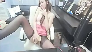 Korean babe in pantyhose fucks big toy