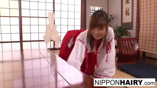 Japanese girl plays with her pussy while some boys peep